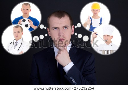 job searching concept - business man thinking or dreaming about his future over dark background - stock photo