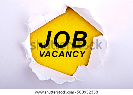 Job Vacancy text under ripped paper. Business, technology, internet concept. Stock Photo