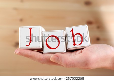 Job word spelled with wooden cubes - stock photo