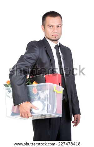 Jobless young man in suit and box with office belongings fired from job isolated on white background. - stock photo