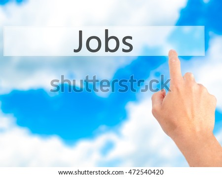 Jobs - Hand pressing a button on blurred background concept . Business, technology, internet concept. Stock Photo