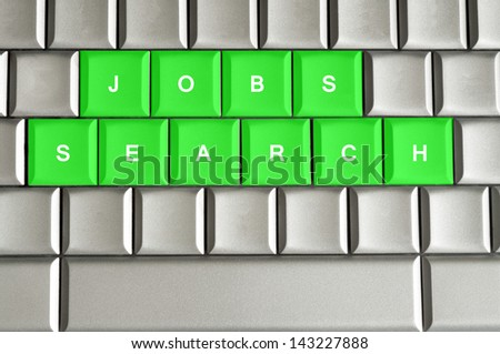 Jobs search spelled on a silver metallic keyboard - stock photo