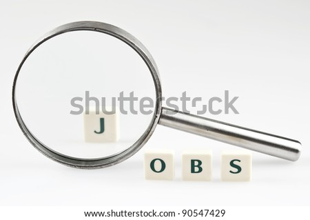 Jobs word and magnifying glass - stock photo