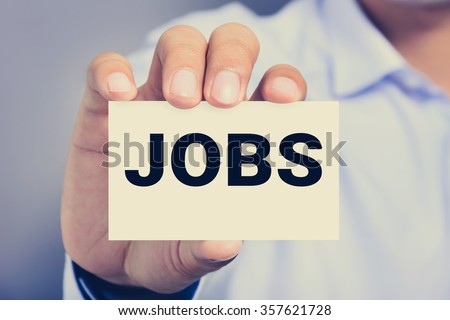 JOBS word on the card shown by a man - stock photo