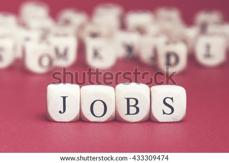 Jobs word written on wood cube with red background - stock photo