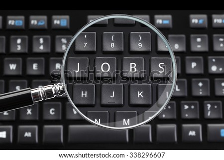 JOBS written on keyboard with magnifying glass