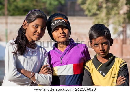 JODHPUR, INDIA - JAN 28: Unidentified children, three best friends, look very seriously on January 28, 2015 in Rajasthan. Rajasthan has a literacy rate of 67.06% and population of 70,000,000 - stock photo