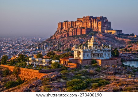 Jodhpur, Rajasthan, India- Sunrise at the Mehrangarh Fort and Jaswant Thada Mausoleum with the blue city in the background - stock photo