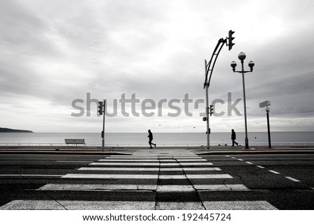 Jogger beside the sea in Nice France - stock photo