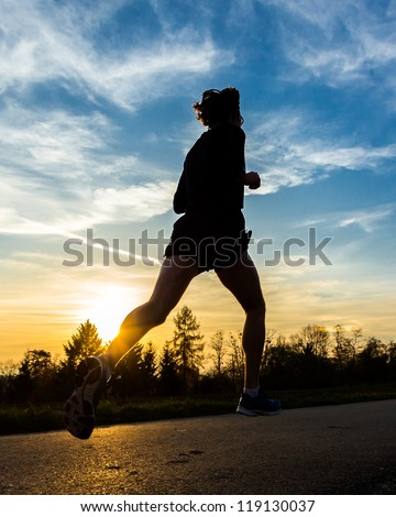 jogger in sunset