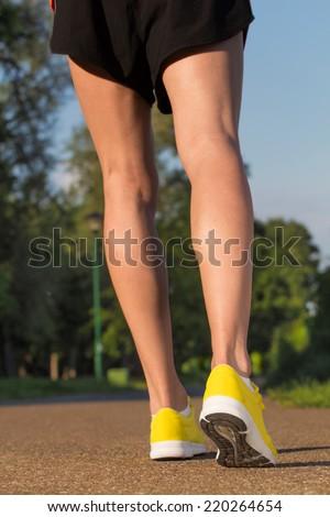 Jogger in sunset/sunrise. - stock photo
