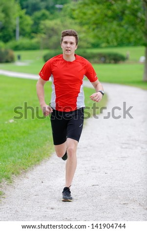 Jogging action, young athlete running in the park