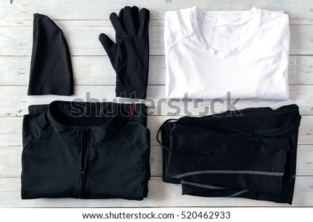 Jogging clothes stacked on a wooden board