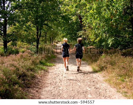 Jogging in the forest. Two women doing fitness.
