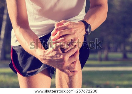 Jogging injury. Warp up before any exercise. - stock photo