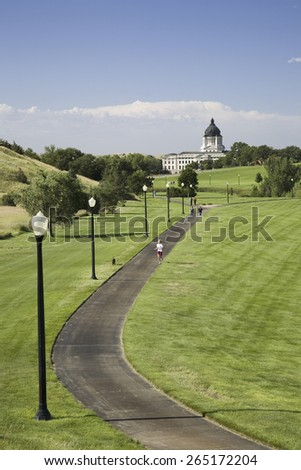 Jogging track in city park leading to South Dakota State Capitol and complex, Pierre, South Dakota - stock photo