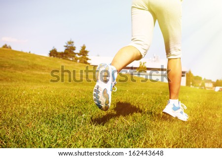 Jogging woman. Fitness and sport concept background. - stock photo