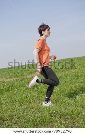 jogging woman outdoors - stock photo
