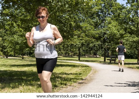 jogging woman overweight - stock photo