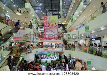 JOGYAKARTA INDONESIA - May 10, 2013: Local people enjoy a dance show at  Mall Malioboro - Mall Malioboro is Yogyakarta's premier shopping mall features a large Matahari department store.  - stock photo