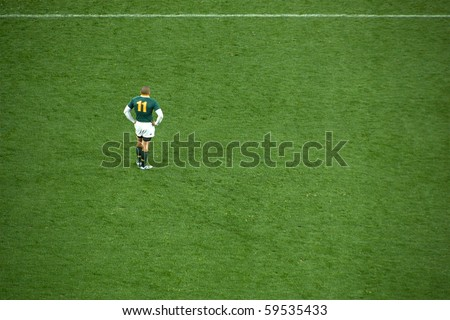 JOHANNESBURG - AUGUST 21: Brian Habana waits for play during the Tri-Nations rugby clash against the New Zealand All Blacks on August 21, 2010 in Johannesburg. NZ beat SA by 29 points to 22. - stock photo