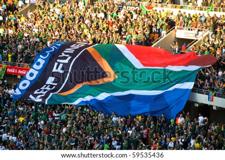 JOHANNESBURG - AUGUST 21: The South African flag at the FNB Stadium in Soweto on August 21, 2010 in Johannesburg.  The game set the record for the highest attendance at a South African Rugby match. - stock photo