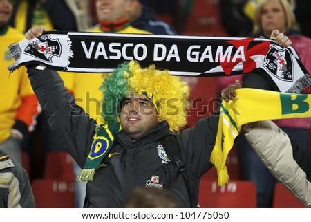 JOHANNESBURG, SOUTH AFRICA - JUNE 15:  A Brazil supporter holds a club scarf at a 2010 FIFA World Cup match June 15, 2010 in Johannesburg, South Africa.  Editorial use only. - stock photo