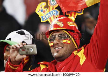 JOHANNESBURG, SOUTH AFRICA - JUNE 21:  A Spain supporter enjoys himself in the stands at a World Cup match June 21, 2010 in Johannesburg, South Africa. - stock photo
