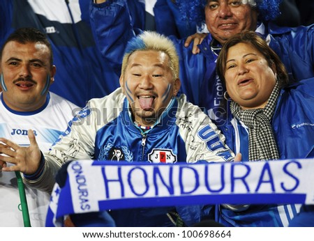 JOHANNESBURG, SOUTH AFRICA - JUNE 21:  Honduras supporters have fun in the stands at a World Cup match June 21, 2010 in Johannesburg, South Africa. - stock photo
