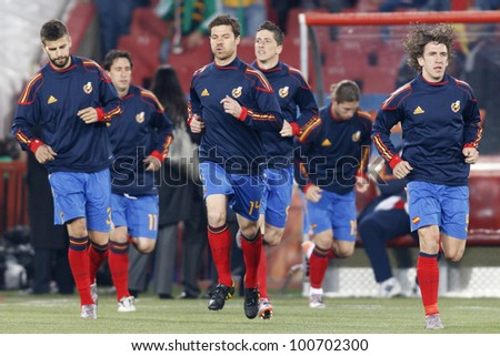 JOHANNESBURG, SOUTH AFRICA - JUNE 21:  The Spain National Team takes the field for warmups before a World Cup match June 21, 2010 in Johannesburg, South Aftica.  Editorial only.  No push to mobile use - stock photo