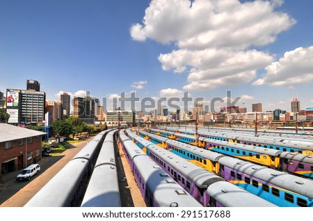 Johannesburg, South Africa - March 26, 2012: The Braamfontein Railway Yards with their colorful cars under the Nelson Mandela Bridge. The yards lie between Newtown and Braamfontein. - stock photo