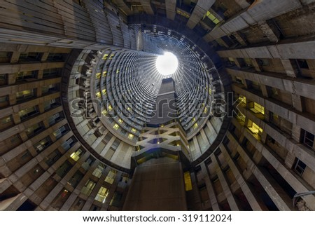 Johannesburg, South Africa - May 25, 2015: Ponte City Building at sunset. Ponte City is a famous skyscraper in the Hillbrow neighbourhood of Johannesburg. - stock photo