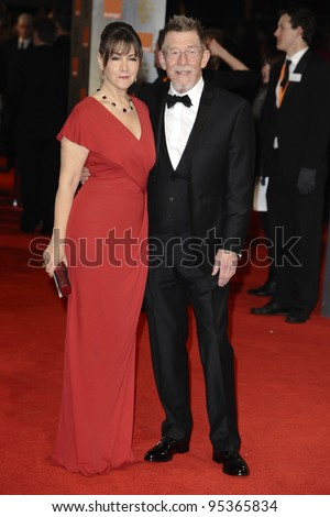 John Hurt and wife arriving for the BAFTA Film Awards 2012 at the Royal Opera House, Covent Garden, London. 12/02/2012  Picture by: Steve Vas / Featureflash