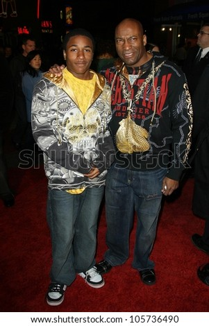 John Singleton and son at the Los Angeles Premiere of 'Fast and Furious'. Gibson Amphitheatre, Universal City, CA. 03-12-09 - stock photo