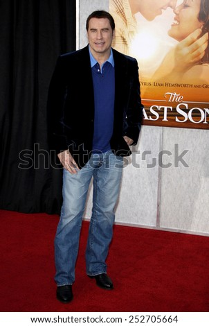 """John Travolta at the World Premiere of """"The Last Song"""" held at the ArcLight Cinemas in Hollywood, California, United States on March 25, 2010.  - stock photo"""