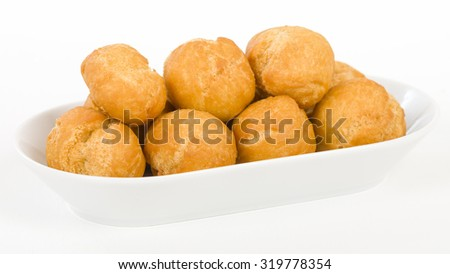 Johnny Cakes - Jamaican fried dumplings in a white bowl. - stock photo