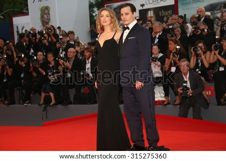 Johnny Depp and Amber Heard attend the premiere of the movie 'BLACK MASS' during the 72nd Venice Film Festival on September 4, 2015 in Venice, Italy. - stock photo
