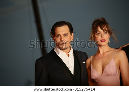 Johnny Depp and  Dakota  Johnson attend the premiere of the movie 'BLACK MASS' during the 72nd Venice Film Festival on September 4, 2015 in Venice, Italy. - stock photo