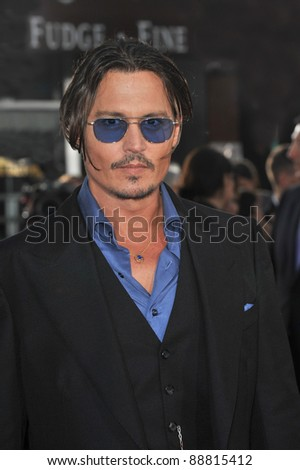 "Johnny Depp at the Los Angeles premiere of his new movie ""Public Enemies"" at Mann Village Theatre, Westwood. June 23, 2009  Los Angeles, CA Picture: Paul Smith / Featureflash"
