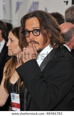 Johnny Depp at the 68th Annual Golden Globe Awards at the Beverly Hilton Hotel. January 16, 2011  Beverly Hills, CA Picture: Paul Smith / Featureflash - stock photo