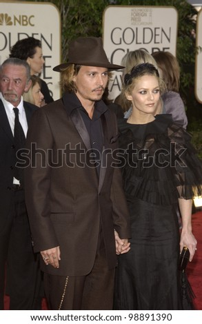 JOHNNY DEPP & VANESSA PARADIS at the 61st Annual Golden Globe Awards at the Beverly Hilton Hotel, Beverly Hills, CA. January 25, 2004
