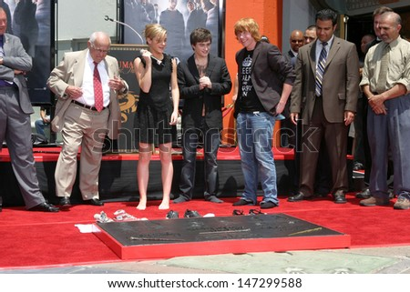 Johnny Grant, Rupert Grint, Daniel Radcliffe, and Emma Watson at the Harry Potter Handprint/Footprint/Wandprint Ceremony Grauman's Chinese Theater Los Angeles, CA July 9, 2007 - stock photo