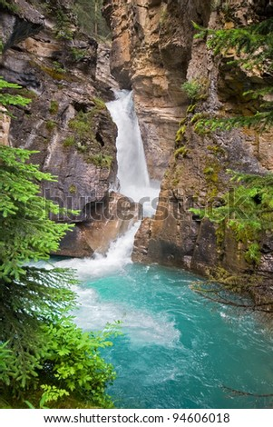 Johnston Canyon, Approximately 15 miles West of Banff, Banff National Park, Alberta, Canada. There are a series of Water Falls that range from 1.1 km (lower falls), to 2.7 km to the Upper Water Fall. - stock photo
