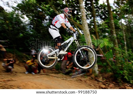 JOHOR BAHRU-JAN 10: An unidentified participant of Malaysia Extreme Downhill Challenge at JP Perdana Park on January 10, 2010 in Johor Bahru, Malaysia. Extreme sport is gaining popularity in Malaysia - stock photo
