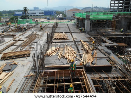 JOHOR, MALAYSIA -APRIL 25, 2016: Aerial view of the construction site in progress at Johor, Malaysia during daytime. Workers busy with their task.