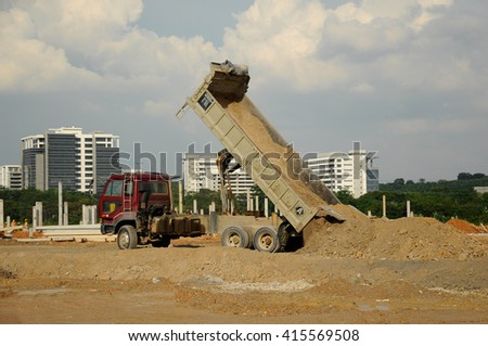 JOHOR, MALAYSIA -APRIL 13, 2016: Construction lorry. Offloading of a truck. Soil is pouring out. - stock photo