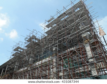 JOHOR, MALAYSIA -APRIL 13, 2016: Scaffolding used as the temporary structure to support platform, form work and structure at the construction site. Also used it as a walking platform for workers.