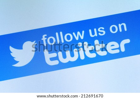Johor, Malaysia - Jun 17, 2014: Follow us on Twitter icon on computer screen, Twitter is a popular free social networking website in the world, Jun 17, 2014 in Johor, Malaysia. - stock photo