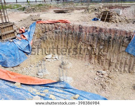 JOHOR, MALAYSIA -JUNE 16, 2015: Pile cap form work with reinforcement bar in it and the excavated pile form work  at construction site in Johor, Malaysia.