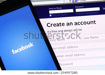 Johor, Malaysia - May 06, 2014: Facebook application on smart phone and notebook screen. Facebook is the world's largest social network, May 06, 2014 in Johor, Malaysia.